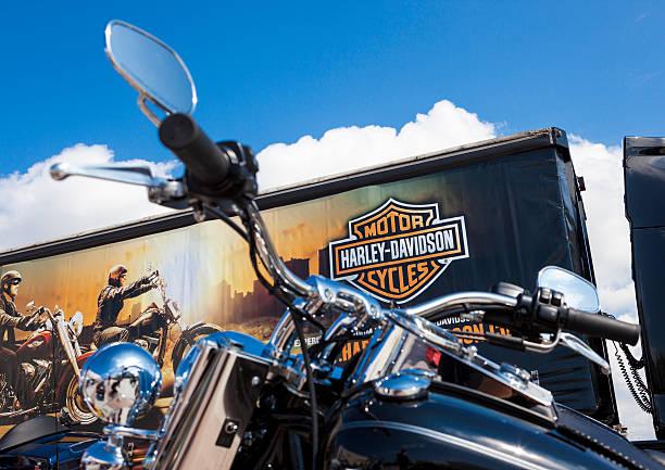 Custom Harley Davidson Motorbike. Antalya, Turkey - May 12, 2013: Harley Davidson is Americas greatest manufacturer of motor cycles. Black custom Harley davidson motorcycle photographed with Harley Davidson Store.Motorbike. 2012 stock pictures, royalty-free photos & images