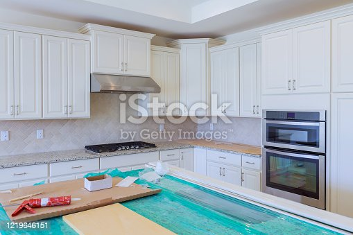 1070686034 istock photo Custom kitchen cabinets of installation base for island in center 1219646151