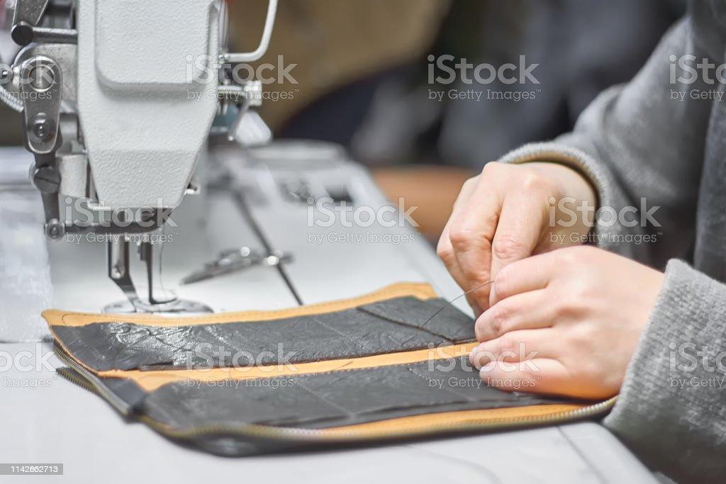 Custom leather item crafting process on workbench