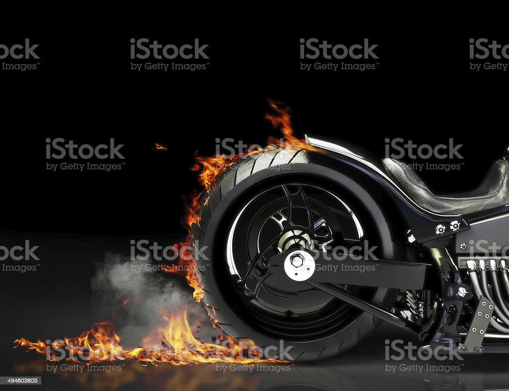 Custom motorcycle burnout on a black background stock photo
