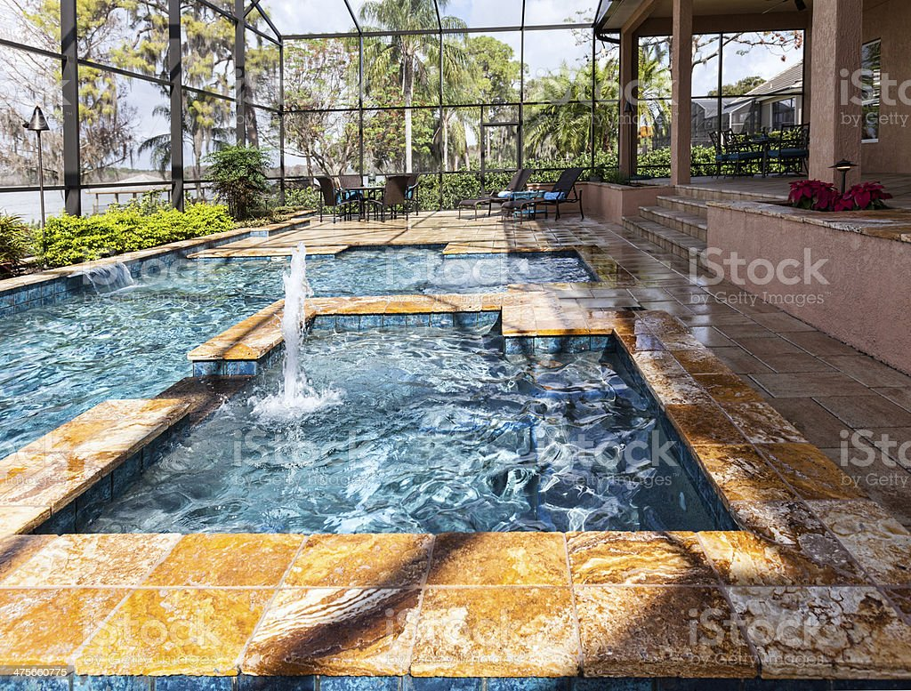 Custom swimming pool with spa and outdoor living space stock photo