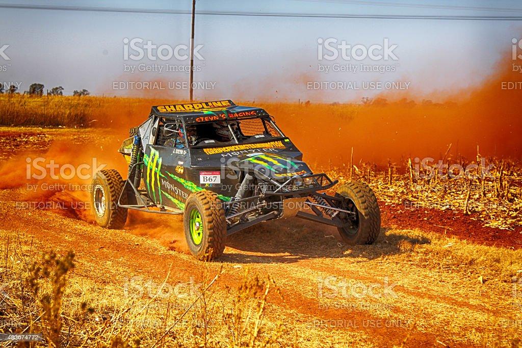 HD - Custom twin seater rally buggy kicking up dust stock photo
