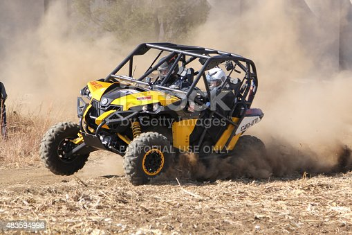 istock Custom twin seater rally buggy kicking up trail of dust 483594996