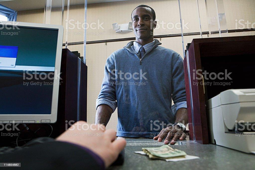 Customer and bank teller stock photo
