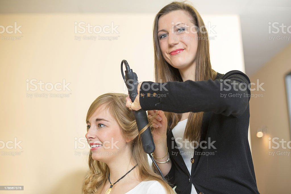 Customer and hairdresser with flat iron royalty-free stock photo