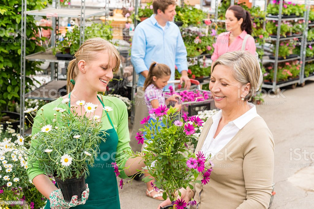 Customer at garden centre buying potted flowers royalty-free stock photo