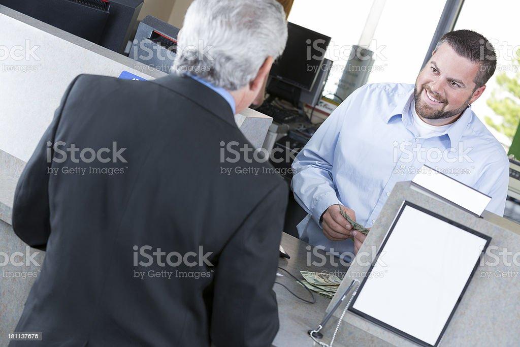 Customer at the bank depositing a check stock photo