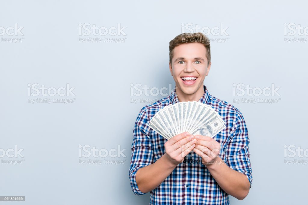 Customer buy buyer  savings currency people person concept. Portrait of excited amazed wondered astonished cheerful rejoicing manager showing many banknotes isolated on gray background copyspace royalty-free stock photo