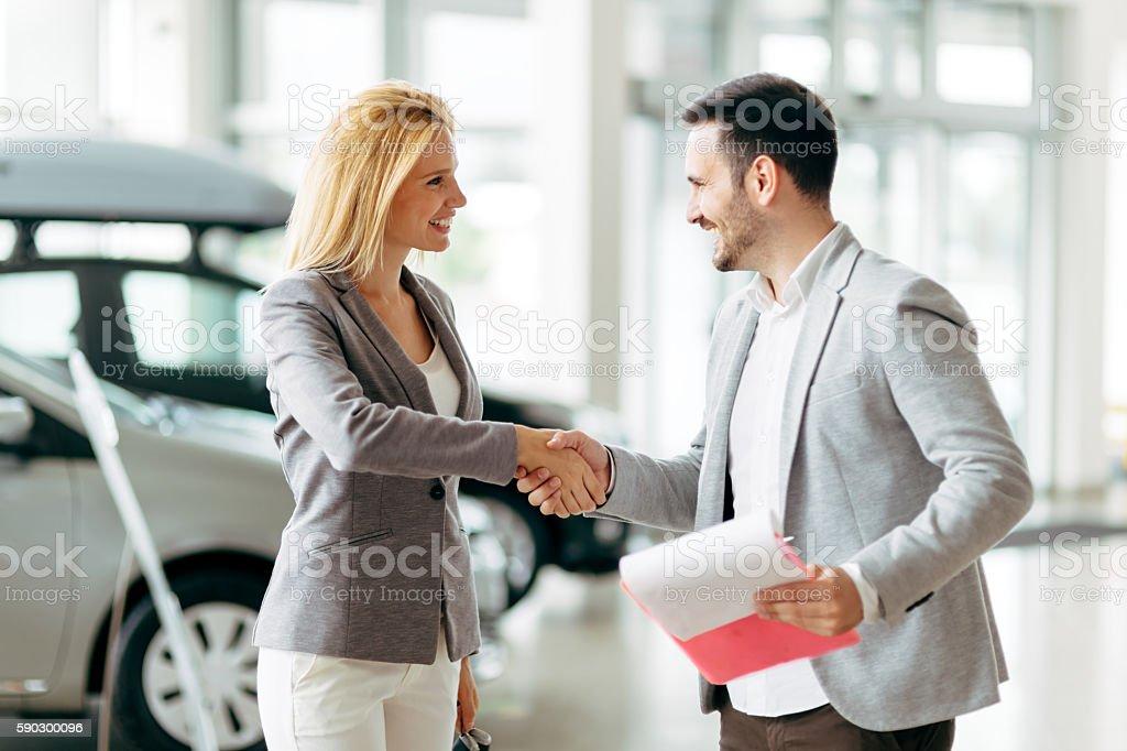 Customer buying a car at dealership stock photo