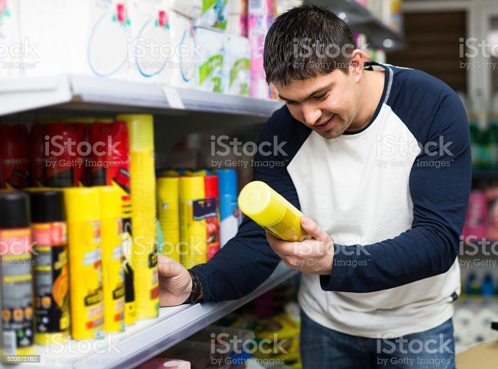customer buying cockroach killer stock photo