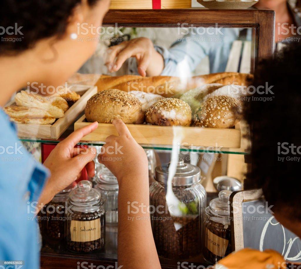 Customer Buying Fresh Baked Bread in Bakery Shop stock photo