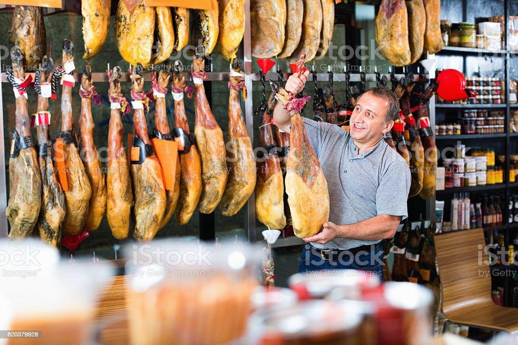 Customer buying iberico or serrano jamon leg zbiór zdjęć royalty-free