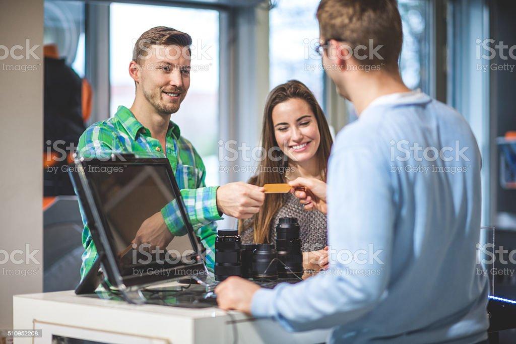 Customer buying photographic equipment stock photo