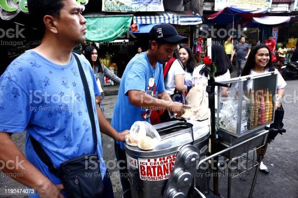 Customer buys ice cream on a cone from a street food vendor picture id1192474073?b=1&k=6&m=1192474073&s=612x612&h=eygqjhxdp2bfpqtwavgyhlcyu8zjp4sx6crz0q6 kyg=