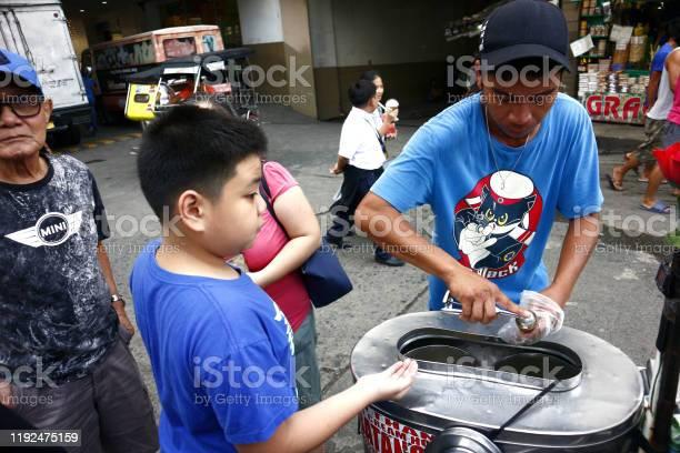 Customer buys ice cream on a cone from a street food vendor picture id1192475159?b=1&k=6&m=1192475159&s=612x612&h=dwucq7jxcbm5rjjlnq 59irpz avenfmqapoejfxrxc=