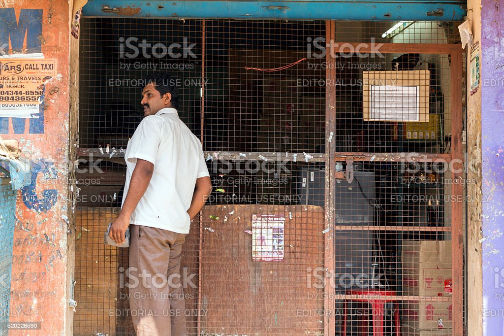 Customer buys liquor in Hosur, Tamil Nadu, India stock photo