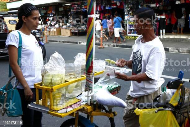 Customer buys sliced green mango from a street food vendor picture id1192473119?b=1&k=6&m=1192473119&s=612x612&h=xteqpuf5fg6nfevgxczt2ouqxtv z8ukncd1s7ngq0y=