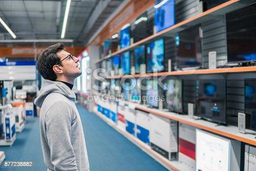 istock customer choosing large fridges in domestic appliances section 877238882