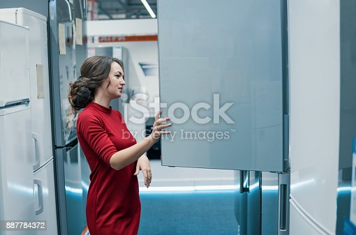 876810414istockphoto customer choosing large fridges in domestic appliances section 887784372
