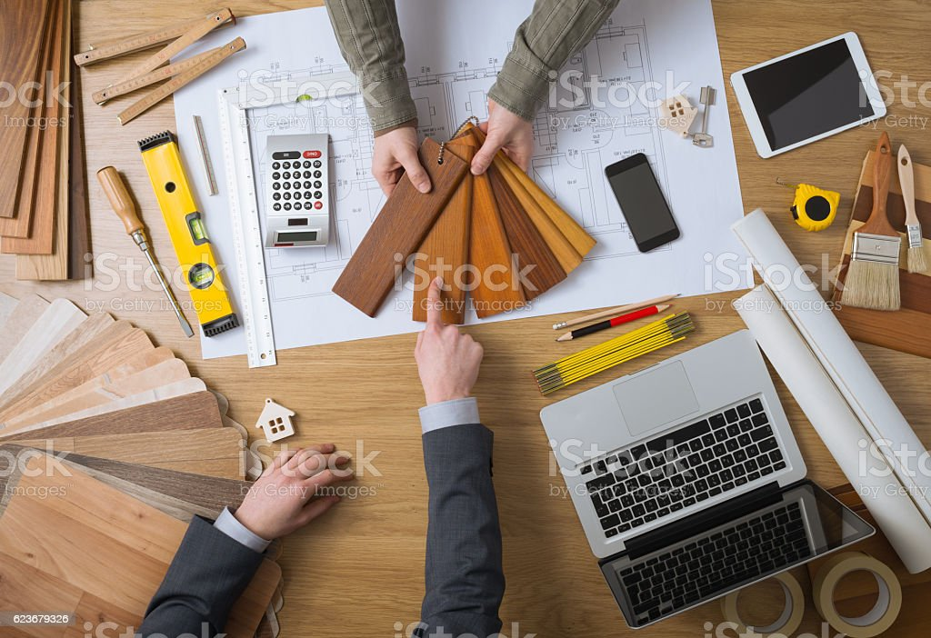 Customer choosing wood swatches stock photo