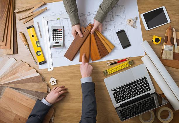 customer choosing wood swatches - 建築家 ストックフォトと画像