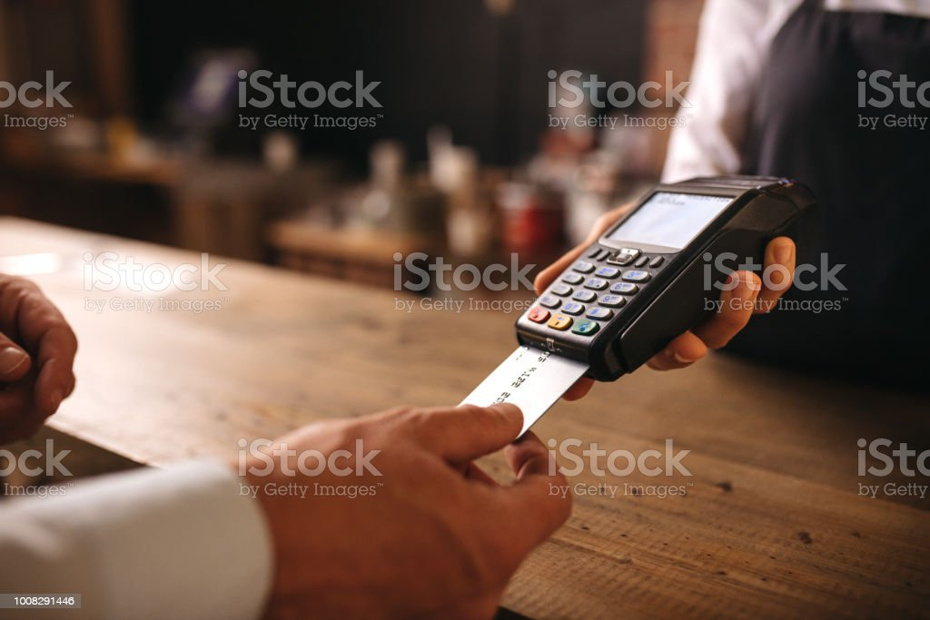 Customer doing payment credit card in cafe stock photo