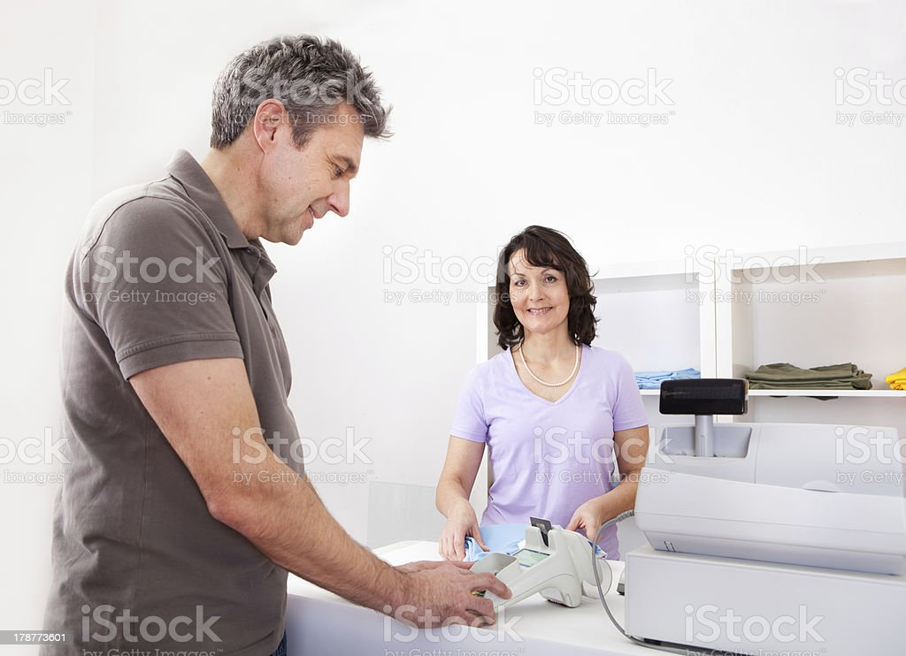 Customer entering pin code stock photo