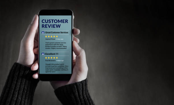 Customer Experience and Online Review Concept. Female holding SmartPhone to Reading Customer Review before Buying Products Customer Experience and Online Review Concept. Female holding SmartPhone to Reading Customer Review before Buying Products adulation stock pictures, royalty-free photos & images