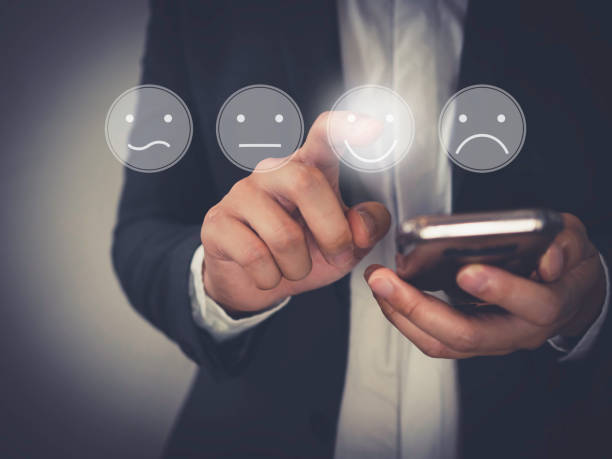 Customer Experience Concept, Business people holding the smartphone with a checked box on Excellent Face and Rating for a satisfaction survey.