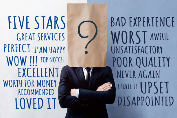 Customer Experience Concept, Happy Businessman Client with Question Mark Icon on Paper Bag, Crossed arms and wearing Suit. Concrete Wall with Wording of Positive and Negative Reviews Customer Experience Concept, Happy Businessman Client with Question Mark Icon on Paper Bag, Crossed arms and wearing Suit. Concrete Wall with Wording of Positive and Negative Reviews adulation stock pictures, royalty-free photos & images