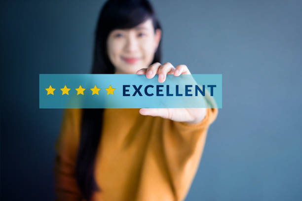 Customer Experience Concept, Happy Woman Show Excellent Rating with Five Star icon for her Satisfaction on transparent label Customer Experience Concept, Happy Woman Show Excellent Rating with Five Star icon for her Satisfaction on transparent label adulation stock pictures, royalty-free photos & images
