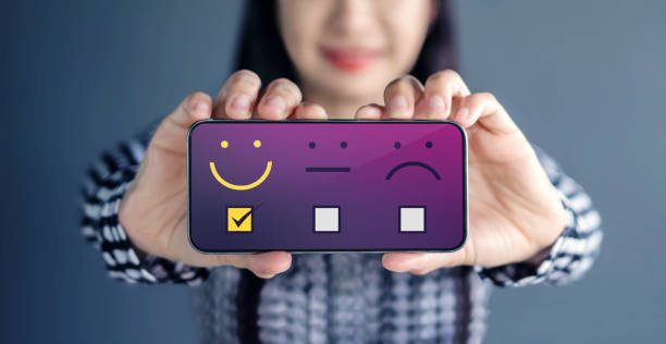 Customer Experience Concept. Happy Woman Show her Satisfaction on Smart Phone with a checked box on Excellent Smiley Face Rating Customer Experience Concept. Happy Woman Show her Satisfaction on Smart Phone with a checked box on Excellent Smiley Face Rating adulation stock pictures, royalty-free photos & images
