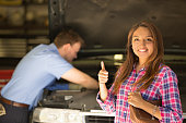 istock Customer gives auto mechanic a happy thumbs-up for great service. 471034360