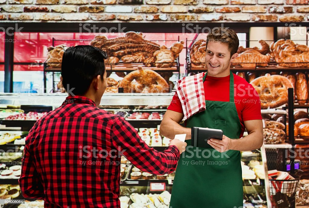 Customer giving credit card to stuff stock photo
