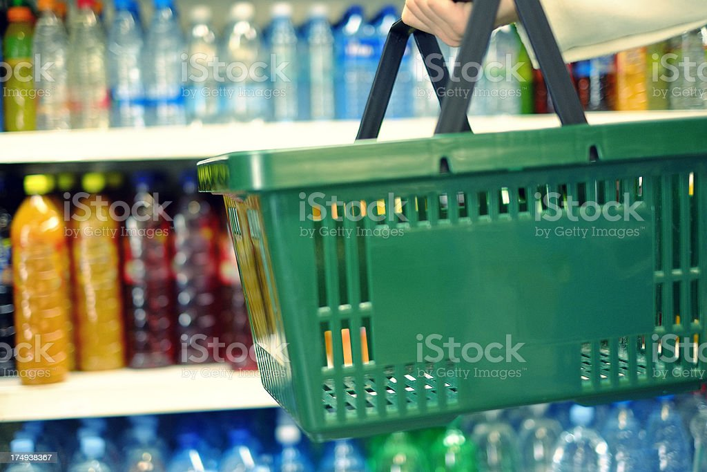 Customer holding shopping basket in the food store stock photo