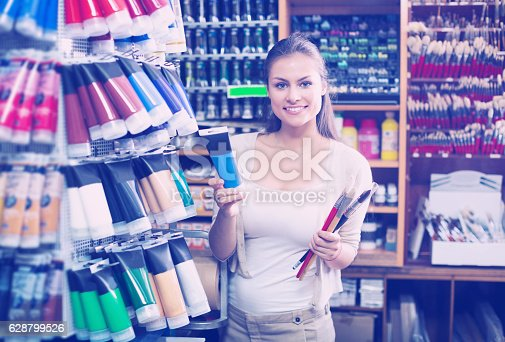 594918592 istock photo Customer holding tube with color paint 628799526