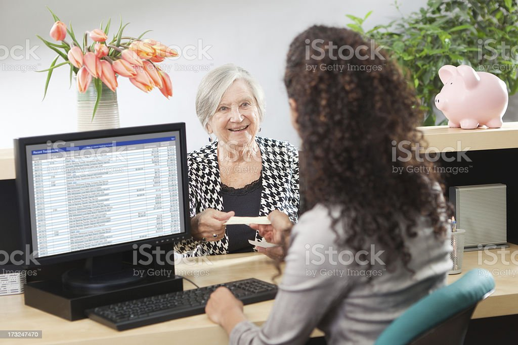 Customer in Retail Banking Counter Window with Bank Teller Hz stock photo