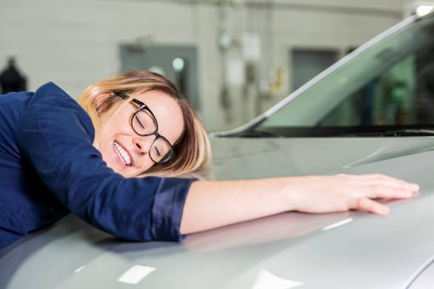 Customer in the garage with repair car stock photo