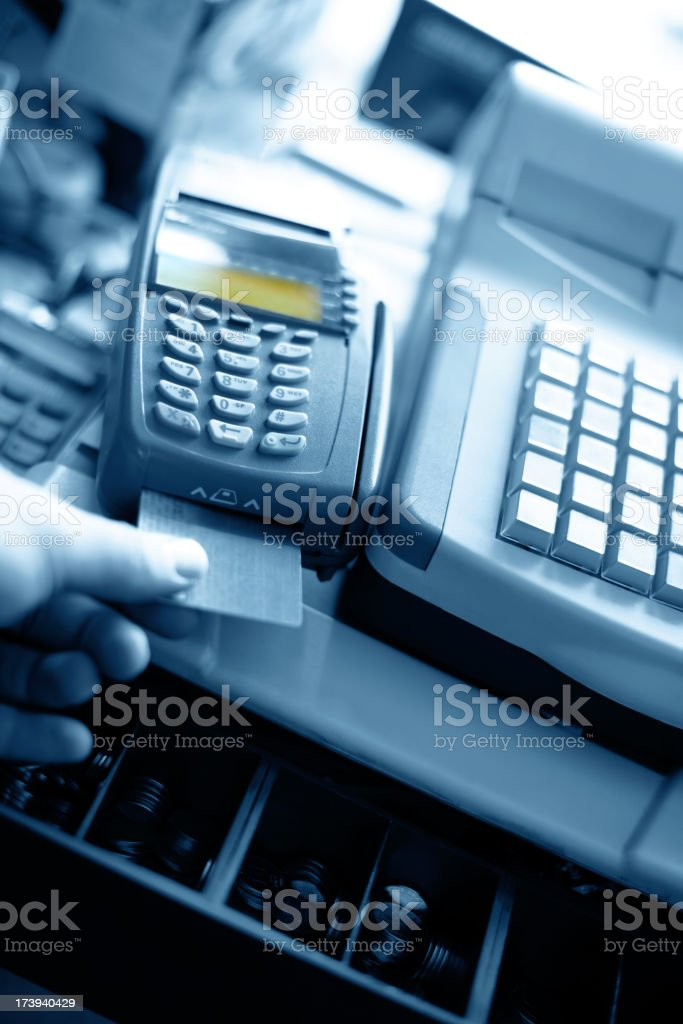 Customer inserting chipped credit card in card reader royalty-free stock photo