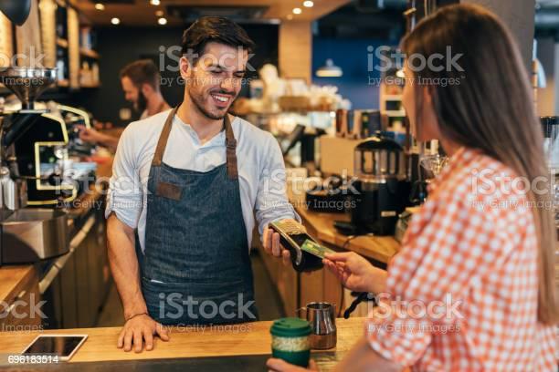 Customer making a contactless payment picture id696183514?b=1&k=6&m=696183514&s=612x612&h=5xcdwakkpcf3okfd2ndgkzyqpcqgnt9p3fb69qsckju=