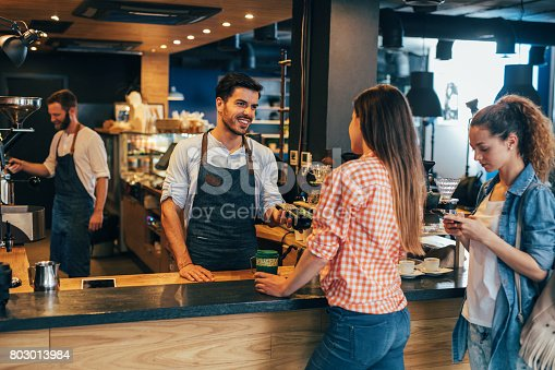 istock Customer making a contactless payment 803013984