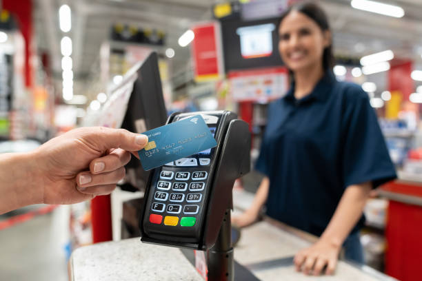 customer making a smart payment at the hardware store - contactless payment stock pictures, royalty-free photos & images