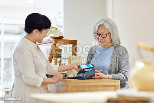 istock Customer making contactless payment in store 1156656766