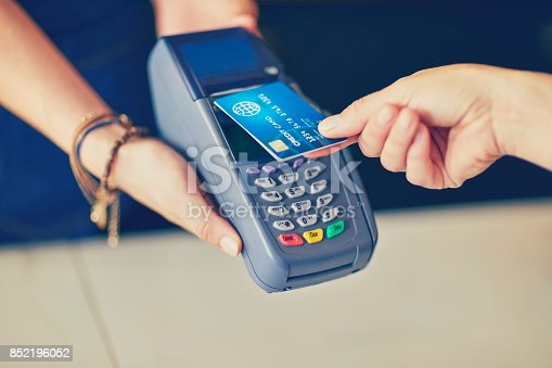 istock Customer making contactless payment through credit card in coffee shop 852196052