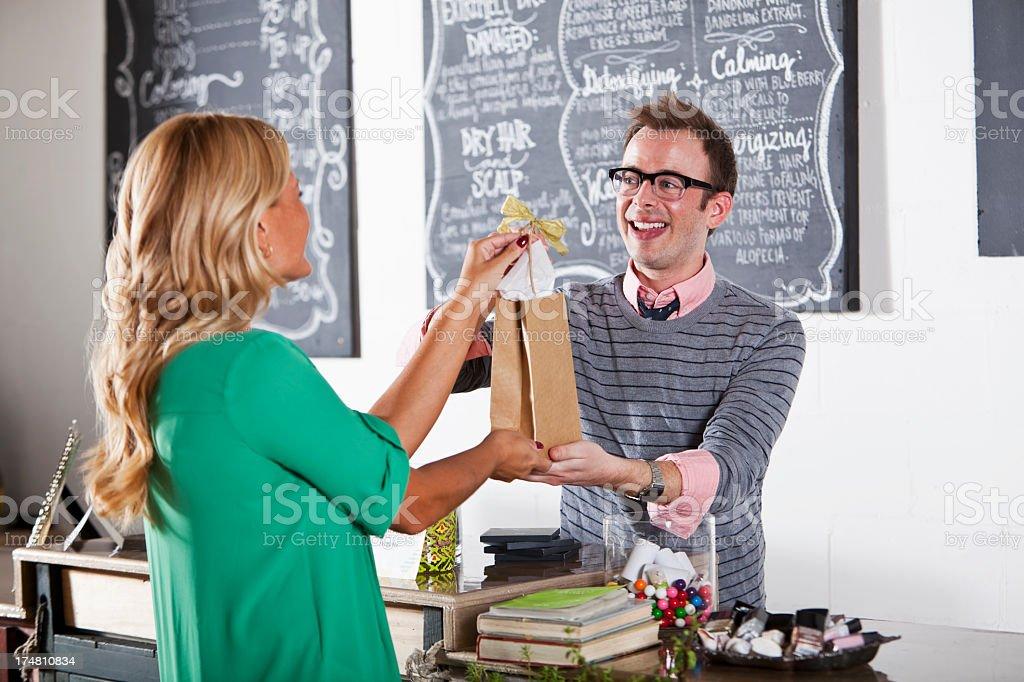 Customer making purchase at beauty salon royalty-free stock photo
