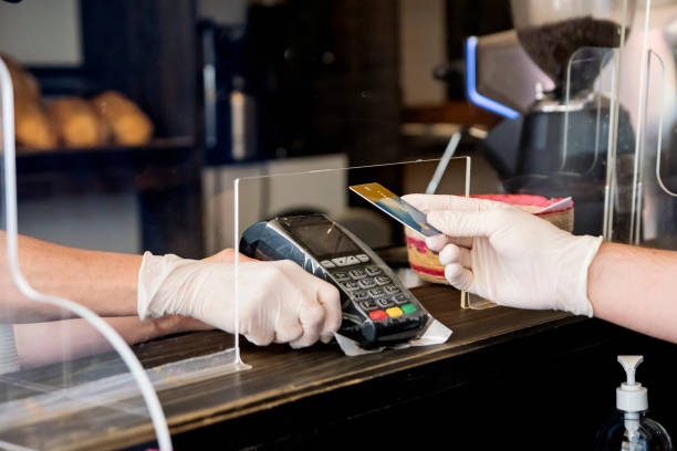 Customer of bakery ready to pay with contact less payment. stock photo