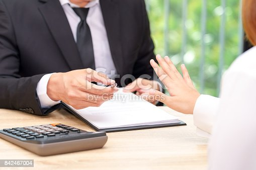 848170878istockphoto Customer or woman says no or hold on when businessman giving pen for signing a contract 842467004
