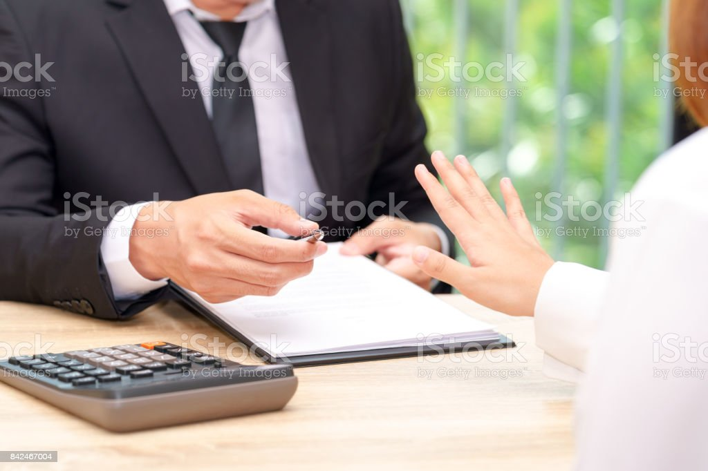 Customer or woman says no or hold on when businessman giving pen for signing a contract stock photo
