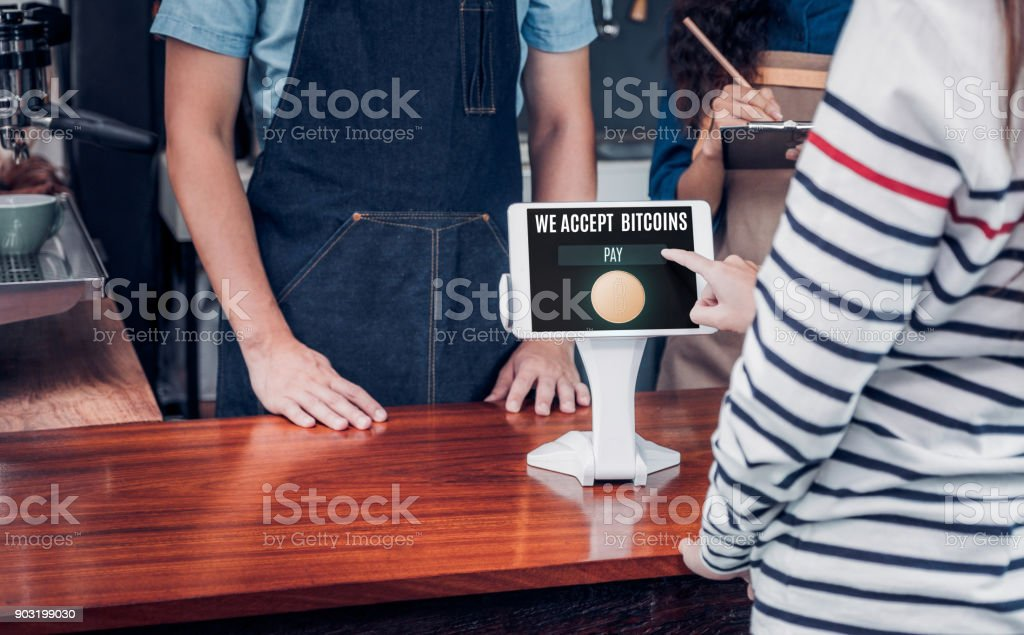 customer pay drink with bitcoins on tablet screen at cafe counter bar,seller coffee shop accept payment by crypto currency.digital money concept. - fotografia de stock