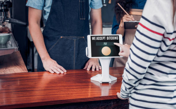 customer pay drink with bitcoins on tablet screen at cafe counter bar,seller coffee shop accept payment by crypto currency.digital money concept. – zdjęcie